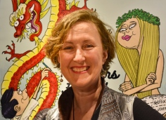 Author Sarah Brennan presents her work at the Hong Kong International Young Readers Festival in Central, Hong Kong, on March 13, 2015. The festival's poster is seen in the background. Katrina Hamlin, 2015.